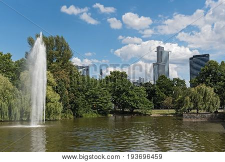 FRANKFURT, GERMANY-JULY 04, 2017: Pond and fountain in the Friedrich Ebert Anlage in Frankfurt, Germany