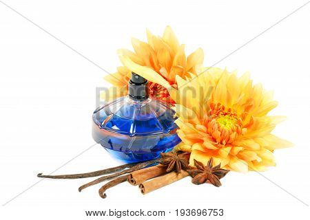 Bottles of perfumes, anise and cinnamon  , over white background.