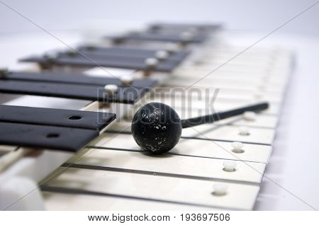 An old musical instrument on a white background