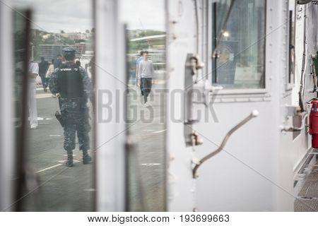 Ship Tour USS Kearsarge (LHD 3) Wasp-class amphibious assault ship: U.S. Navy security personnel on patrol reflection in a window, flight deck. Fleet Week NEW YORK MAY 25 2017.