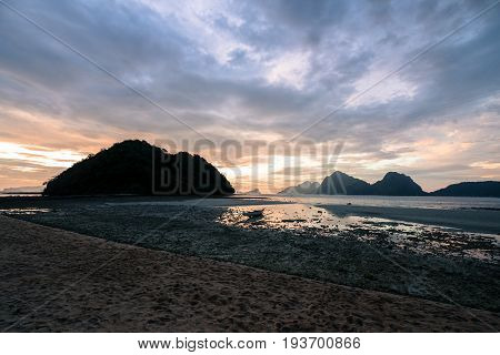 EL NIDO, PALAWAN, PHILIPPINES - MARCH 29, 2017: Horizontal picture of a beautiful sky at the sunset of Las Cabanas Beach.
