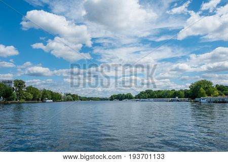 lake landscape river spree with tour boats and beautiful sky and clouds