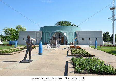 SIOUX FALLS, SOUTH DAKOTA - JUNE 21, 2017: The USS South Dakota Memorial main entrance. A concrete outline depicts the actual dimensions of the highly decorated warship.
