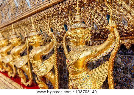 Perspective view of golden religious statue (Statue Garuda) in wat phra kaew temple Bangkok Thailand.