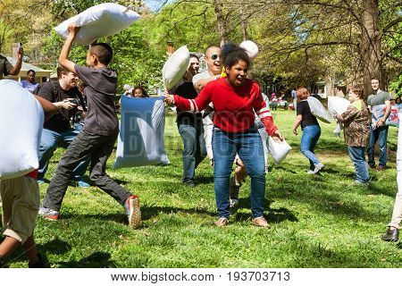 ATLANTA, GA - APRIL 2017: People have fun hitting each other with pillows on International Pillow Fight Day in Grant Park in Atlanta GA on April 1 2017.