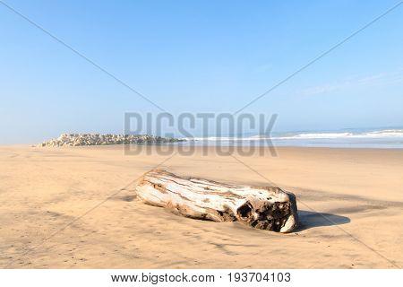 Beach at Atlantic ocean in France with stone surf breaker