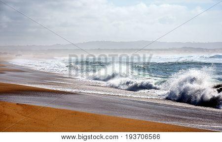 Wave and sand beach for background. Beautiful beach surface texture. Sea wave on sand beach digital illustration. Oceanic water tide on seashore. Belmont beach Australia.