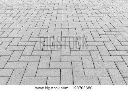 Concrete paver block floor pattern for background.