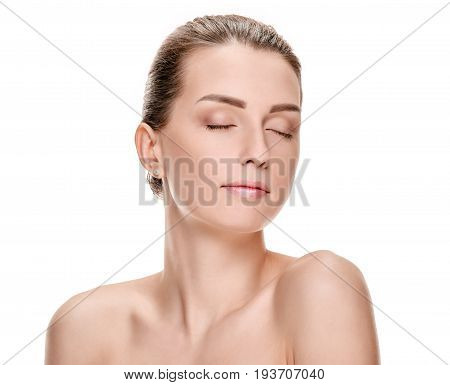 Portrait of pretty minded woman posing on white background