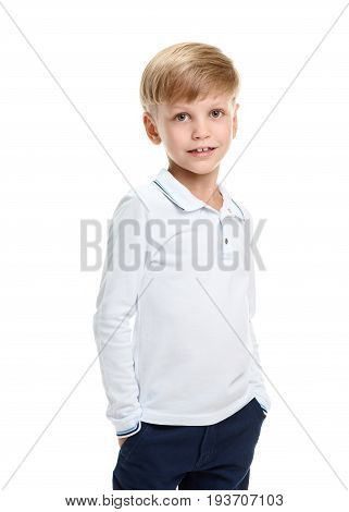 Portrait of cute young boy holding hands in pockets