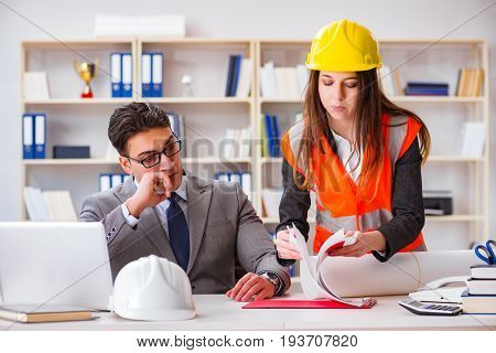 Construction foreman supervisor reviewing drawings