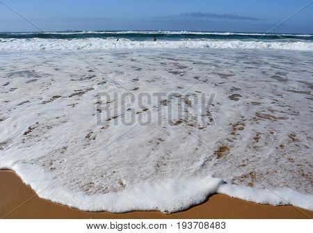 Wave and sand beach for background. Beautiful beach surface texture. Sea wave on sand beach digital illustration. Oceanic water tide on seashore.
