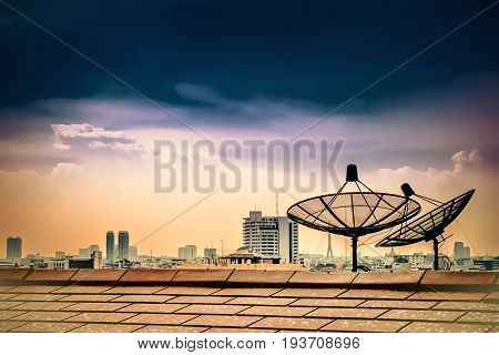 Satellite dish on the roof with dark sky and clound