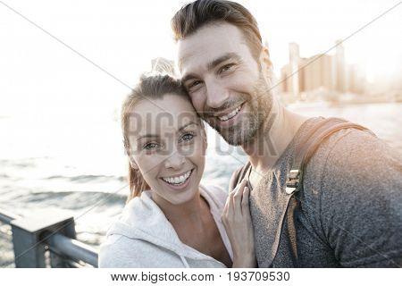 In love couple enjoying sunset on Brooklyn heights, NYC