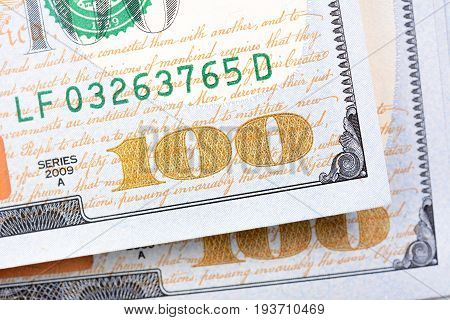 Close up of number one hundred on US dollar (USD) money