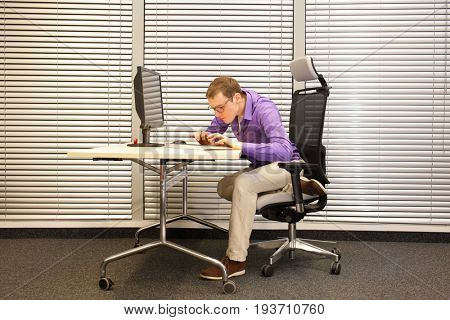 Near-sightedness, myopia. Caucasian office worker at work station