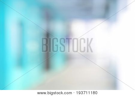Blur light blue abstract background from building hallway (or corridor) hospital hallway concept