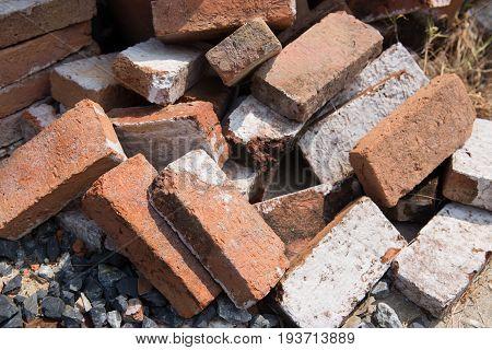 Red brown bricks lay on floor.