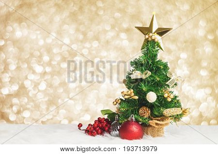Christmas Tree With Cherry And Ball Decorate On White Fur With Blue Gold Bokeh Sparkle Light Backgro