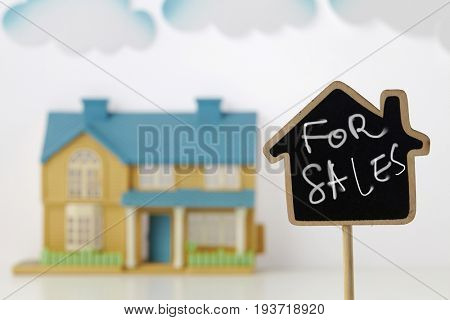 house shape blackboard in front of the model house as background