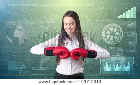 Young Beautiful Woman Dress In Suit Standing In Combat Pose With Red Boxing Gloves. Business Concept