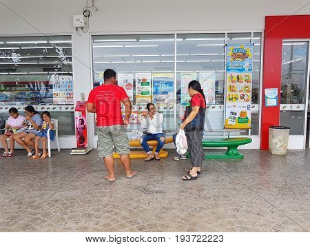 CHIANG RAI THAILAND - MAY 7 : unidentified asian people or tourists relaxing in front of 7-eleven shop on May 7 2017 in Chiang rai Thailand.