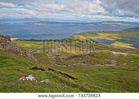 General view from The Storr with Loch Leathan and the Isle of Raasay in the background, Isle of Skye, Highlands, Scotland, UK