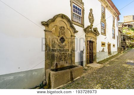 MONSANTO,PORTUGAL - MAY 16,2017 - Chafariz house in the streets of Monsanto village in Portugal. Monsanto has become popularly known as