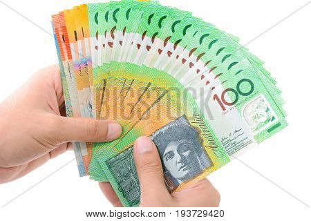 Hands holding money Australian dollar (AUD) banknotes isolated on white background