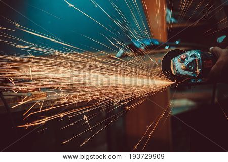 Sparks During Cutting Of Metal Angle Grinder. Close-up Saw Sawing A Steel