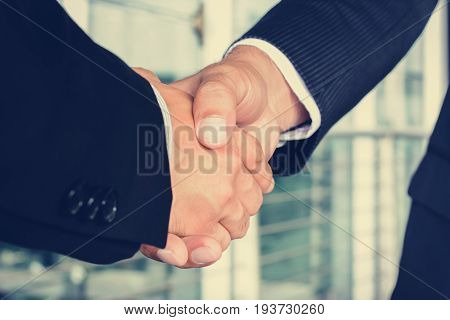 Handshake of businessmen - greeting dealing mergers and acquisition concept