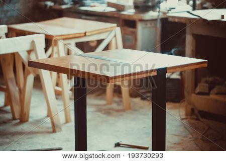 Beautiful Finished Table With Natural Iron And Wood Stands On The In A Carpenter's Shop
