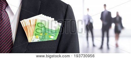 Money Euro currency (EUR) banknotes in businessman suit pocket on blur businesspeople background - business and financial panoramic (header) background concept