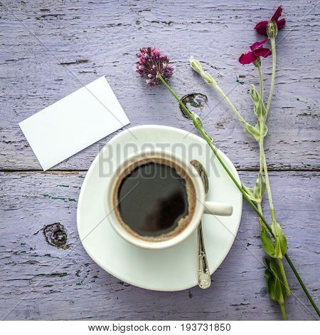 Business card, cup of steaming coffee, topview