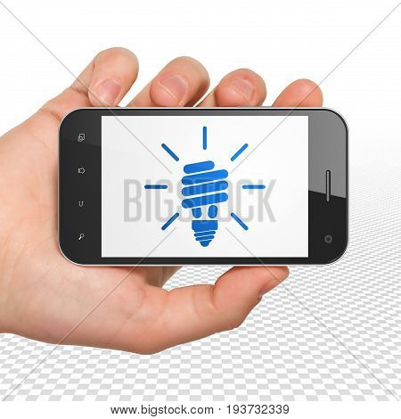 Finance concept: Hand Holding Smartphone with  blue Energy Saving Lamp icon on display,  Tag Cloud background, 3D rendering