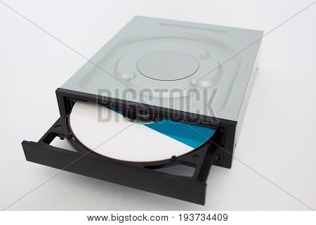 Opened CD - DVD drive with a black cap and disk inside. Isolated.