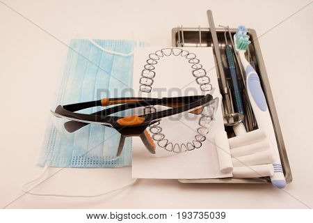 Set of dental tools and accessory for teeth care. Isolated on white background.