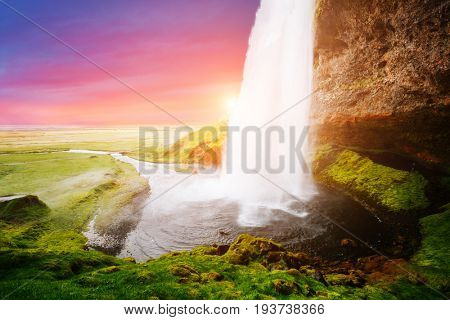 Stunning image of powerful Seljalandsfoss waterfall in sunlight. Dramatic and gorgeous scene. Popular tourist attraction. Location place Iceland, sightseeing Europe. Discover the world of beauty.