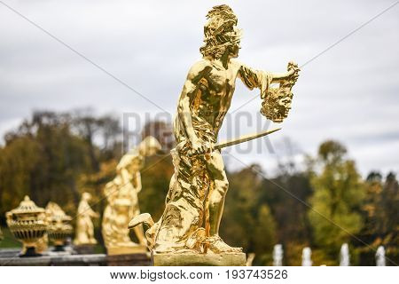 Peterhof Russia October 5 2016: Golden sculpture in the park in Peterhof Palace in Russia.