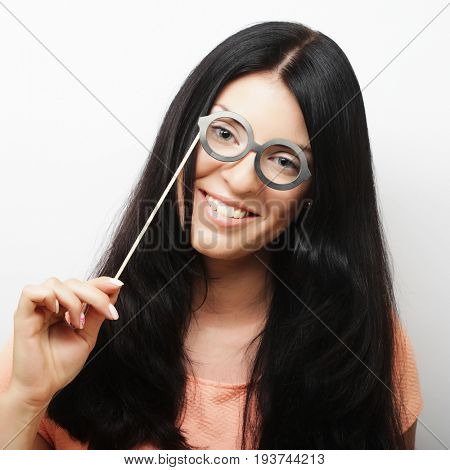 Attractive playful young woman with false glasses, ready for party
