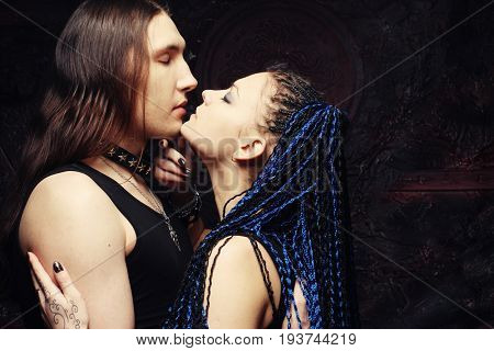 Dark couple - young woman and young man