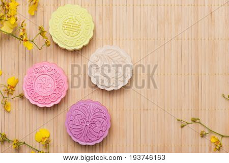 Traditional mooncakes on table with copyspace. Sweet color of snow skin mooncake.