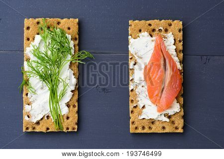 Healthy lunch, of crispbread with fish, cream cheese and greens