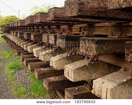 Wagon With Extracted Old Railways. Concrete And Wooden Sleepers With Rail Rods