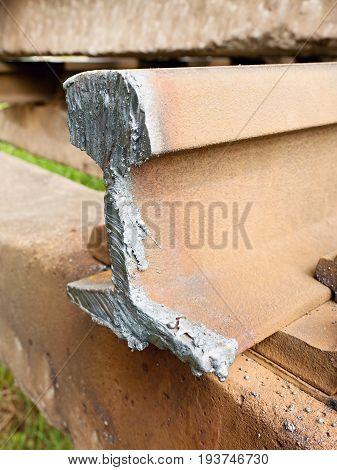 Detail Of Cut Rail. Autogen Torch  Cut Rail Rod On Concrete Sleeper. Repair Of Tramway.