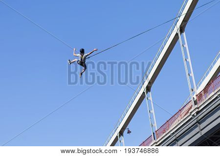 Leap from the bridge with the rope. Extreme sport, jumping, adrenaline. The man jumped from the bridge with the rope.
