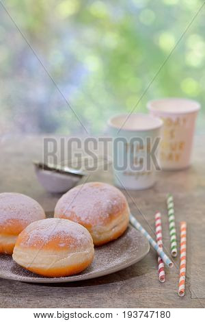 Fresh tasty donuts with jam, close up