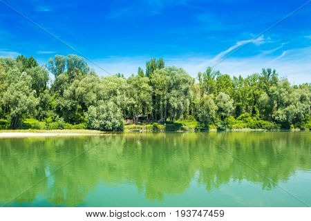 Beautiful jungle landscape, confluence of Mura and Drava rivers in Medjimurje, Croatia, cottage in the wood