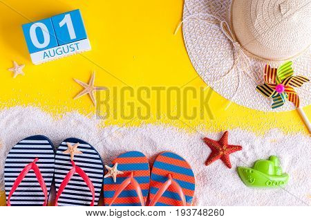 August 1st. Image of august 1 calendar with summer beach accessories and traveler outfit on background. Summer vacation concept.