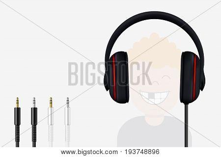 Headphone And Mini Jack Plugs. Joyful Boy Listening To Music